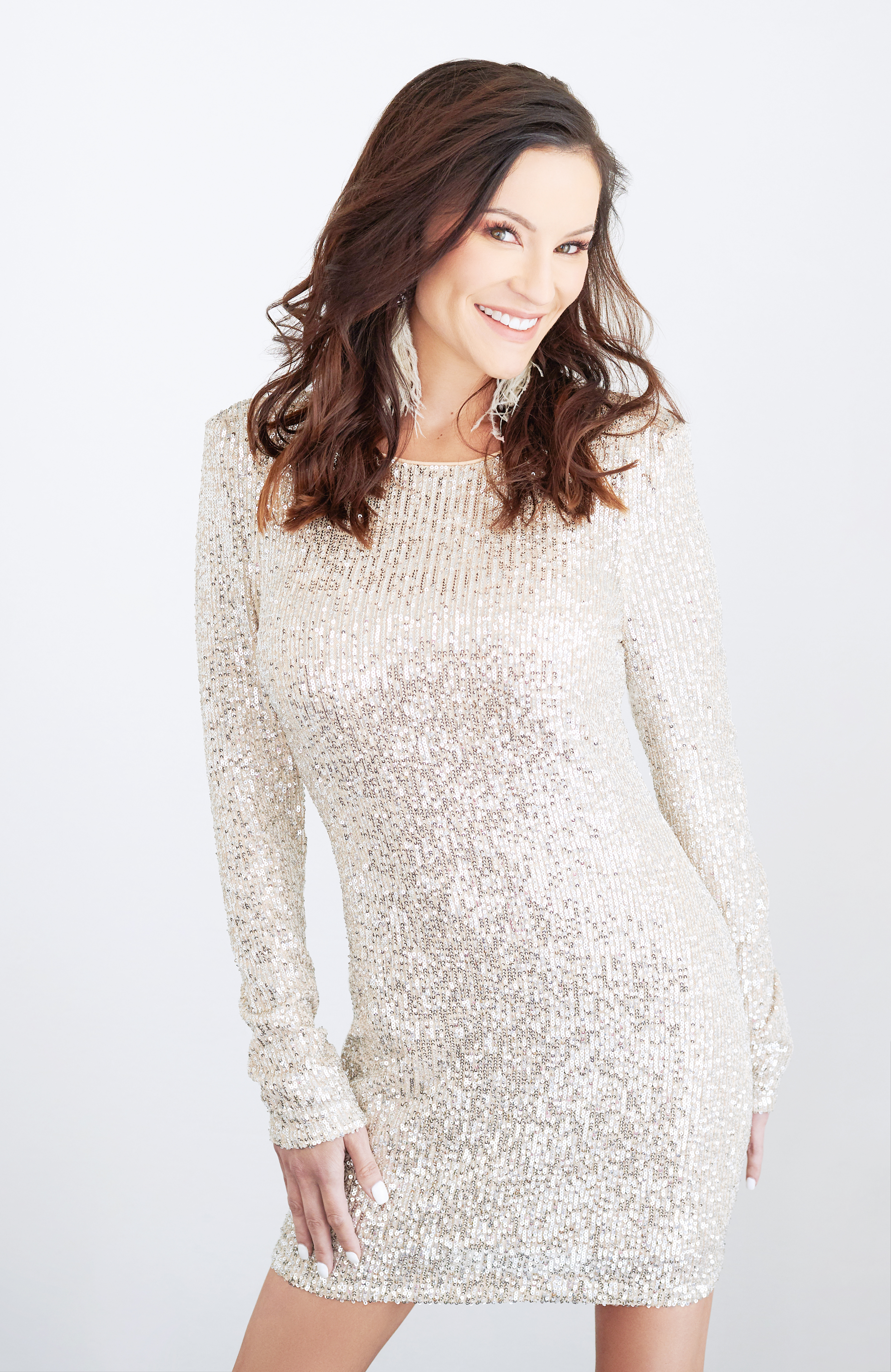 Beautiful smiling brunette woman with sparkly white/silver dress
