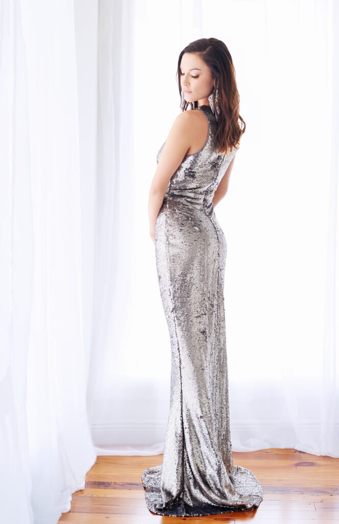 Beautiful brunette woman with sparkly silver dress